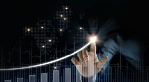 Businessman plan growth and increase of positive indicators on dark background