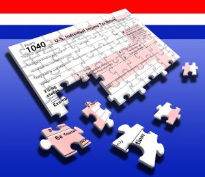 A U.S. individual income tax return has been turned into a jigsaw puzzle to represent the annual task of trying to piece together financial information during tax filing season. A mock version of a Form 1040 tax return is seen here with pieces missing as the tax return is being prepared for the April 15 annual deadline.