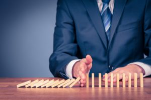 Risk manager stop domino effect of business going into serious debt