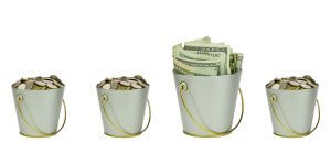 Three buckets with coins and one with banknotes