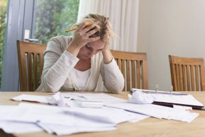 Woman worried about financial problems. Jobless or to many bills