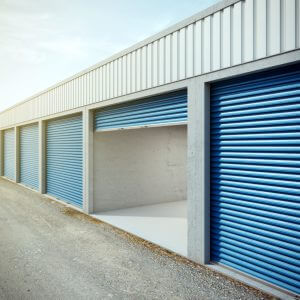 Empty storage unit with opened door. 3d rendering