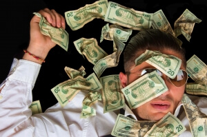 Man covered with US dollars,drowning in debt concept