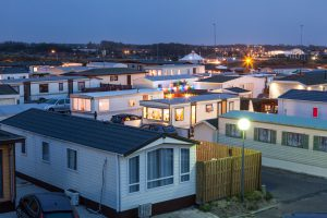 Trailer park illuminated at dusk in Holland, Netherlands