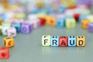 Fraud word on colorful dices