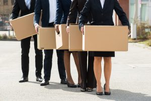 Close-up Of Businesspeople With Cardboard Boxes Standing In A Line;Outdoor