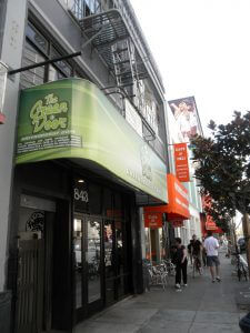 San Francisco, United States - September 28, 2011: People move along the sidewalk in front fo the Green Door, medical marijuana pot shop store in SOMA taken on September 28, 2011 in San Francisco.