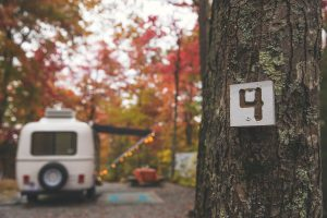 Camper camping at RV park in autumn in North Carolina Blue Ridge Mountains outside of Asheville.