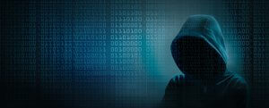 young hacker with hood and binary code