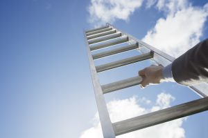 Businessman climbing the corporate ladder of success