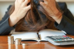Stressed business woman running out of money - stock and market down