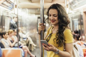 Beautiful woman using phone in the subway of New York.