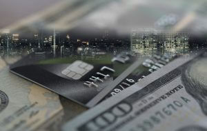 Finance and economy concept. Credit card,money with business city background.