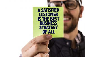 A Satisfied Customer Is The Best Business Strategy of All sign