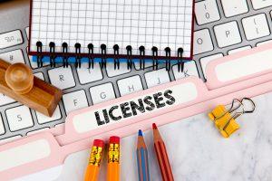 Licenses concept. Folder Register on Background of Computer Keyboard