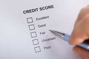 High Angle View A Person Filling Credit Score Form
