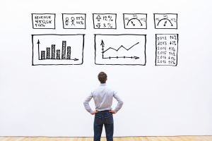 business analytics concept, businessman looking at dashboard with charts and graphs