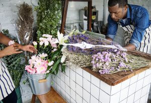 Man using computer laptop in flower shop